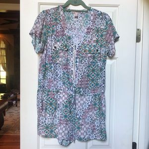 Patterned romper with zipper in front and string